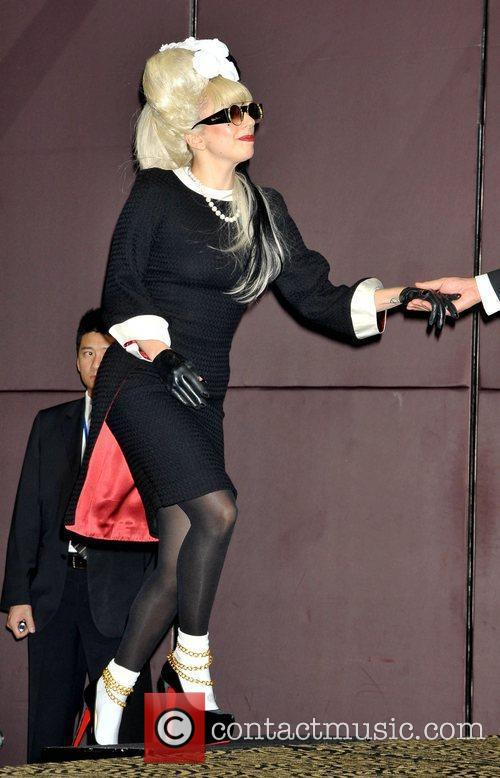 Lady Gaga attends a photocall during her first...