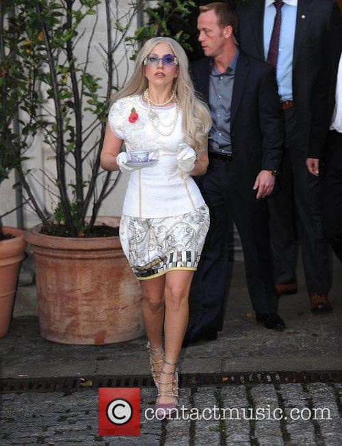 Lady Gaga leaving her hotel carrying a cup...