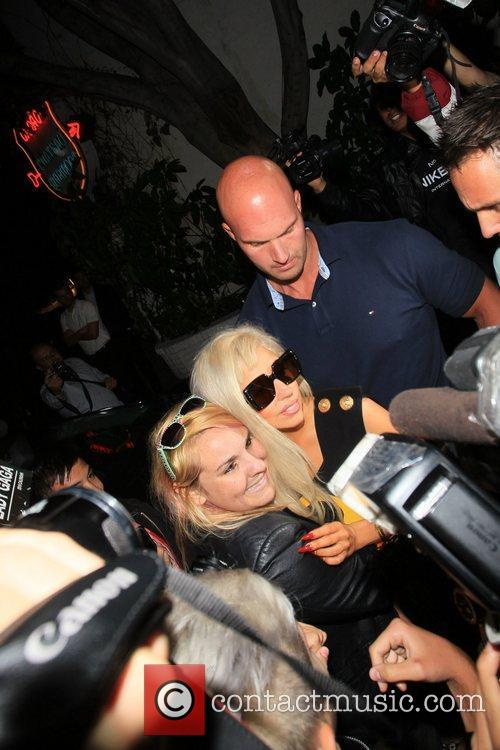 Lady Gaga arrives at her hotel and is...