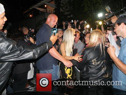 Lady Gaga at her hotel surrounded by fans...