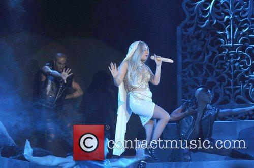 Performs during the closing party following the first...