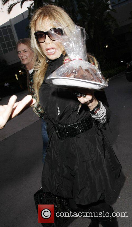 As she arrives at the Staples Center for...