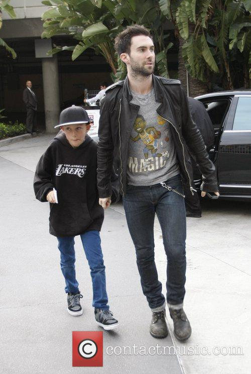 Adam Levine and his son Celebrities attend an...