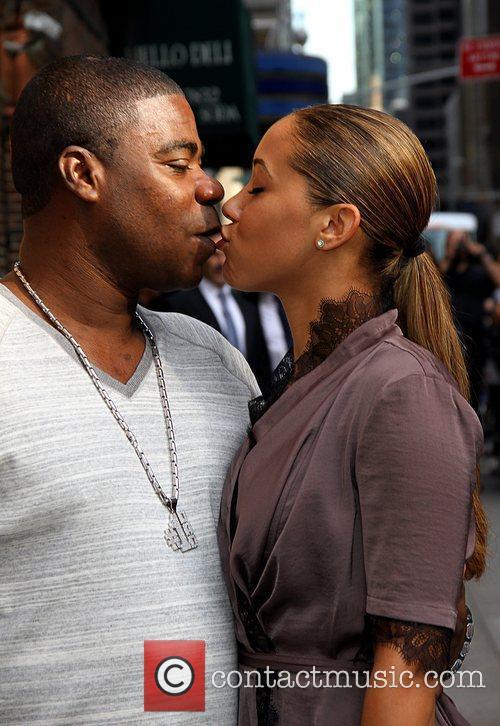 Tracy Morgan and Megan Wollover share a kiss...