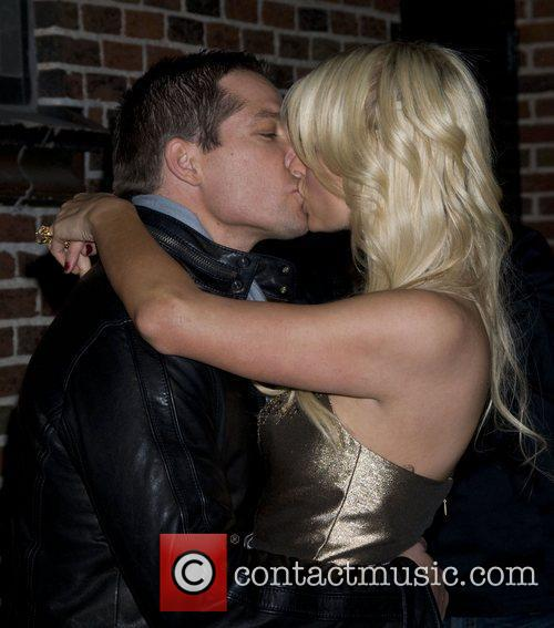 Cy Waits and Paris Hilton kiss 'The Late...