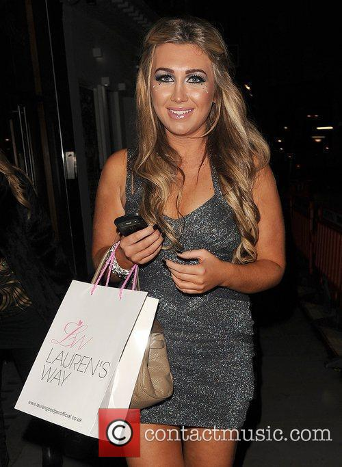 Lauren Goodger leaving her launch party for her...