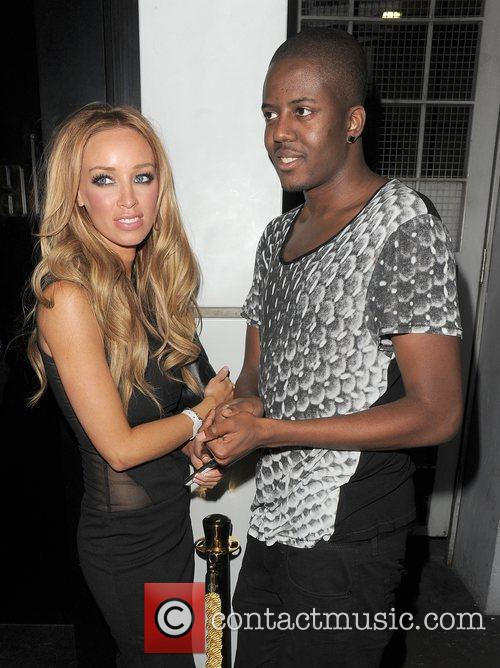 Lauren Pope comes out of Merah nightclub to...