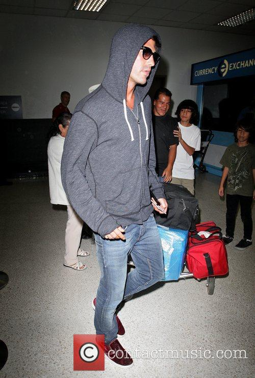 Brandon Davis arriving at LAX airport on a...
