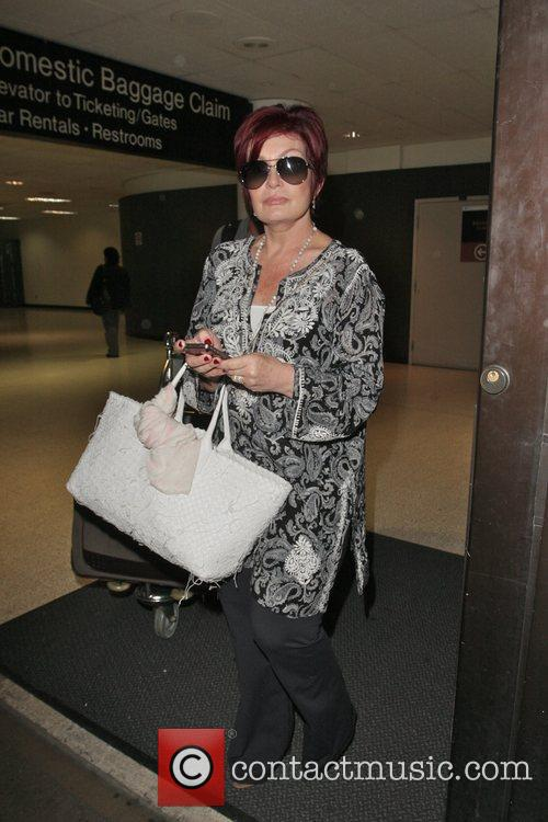 Arriving at LAX airport on a flight from...