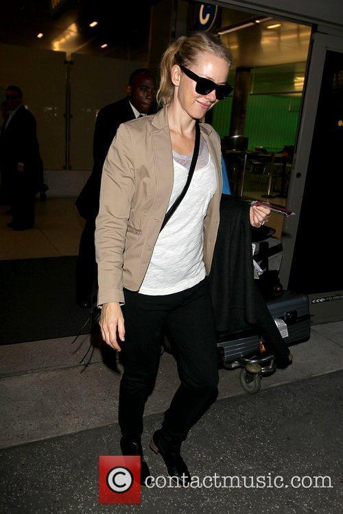 Wearing a beige blazer as she arrives at...