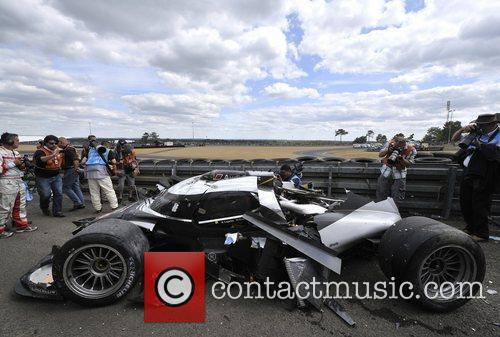 Alan McNish from the Audi team crashes his...
