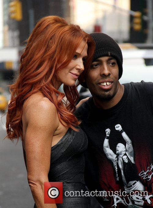 Poppy Montgomery posing with a fan 'The Late...