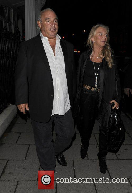 Philip Green and his wife leave a private...