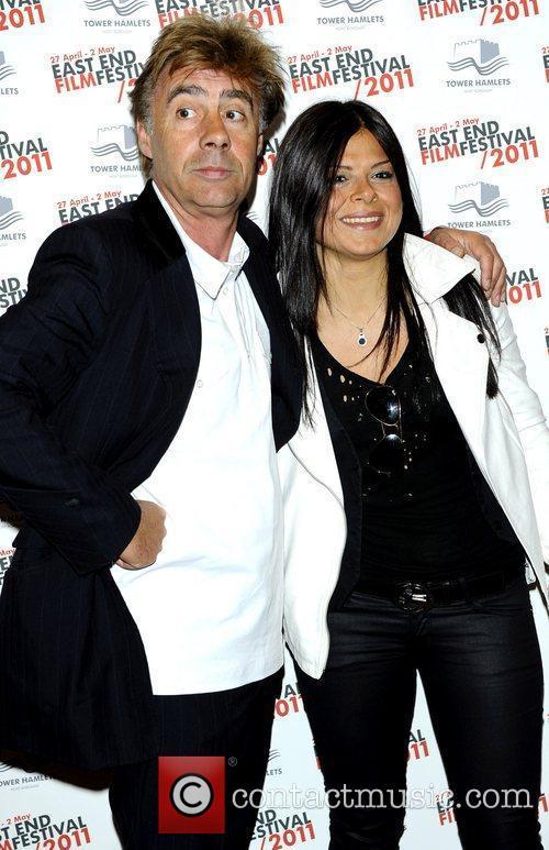 Glen Matlock (Sex Pistols) and female companion attend...
