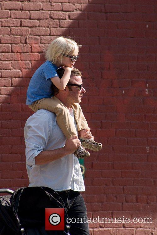 Liev Schreiber carries his son Sasha Schreiber while...