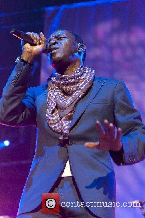 Tunde Baiyewu of the Lighthouse Family performing live...