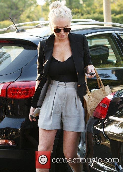 Lindsay Lohan leaves her Porsche Panamera in a...