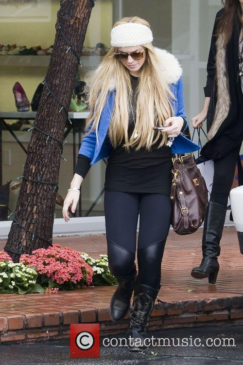 Lindsay Lohan goes for some retail therapy at...