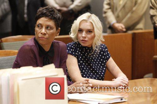 Lawyer Shawn Chapman Holley and Lindsay Lohan inside...