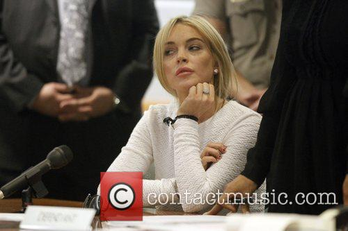 * LOHAN CHARGED Prosecutors in Los Angeles have...