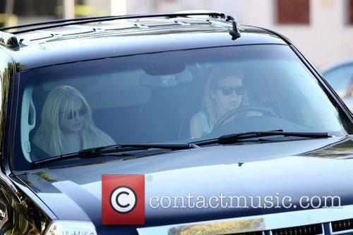 Lindsay Lohan being driven away as she leaves...
