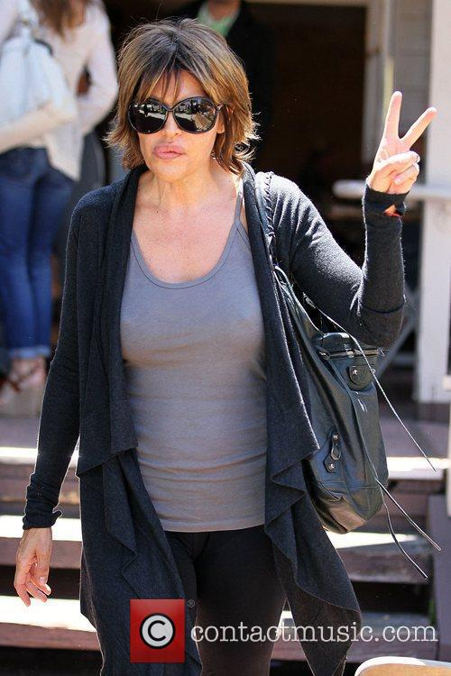 Lisa Rinna leaving Le Pain Quotidien after having...