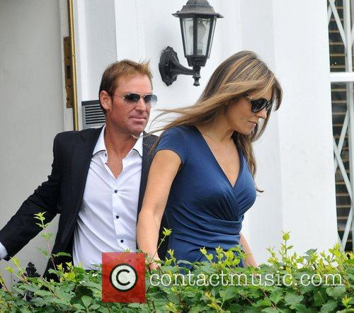 Elizabeth Hurley and Shane Warne are seen leaving...
