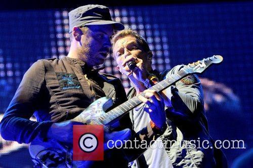 Jonny Buckland and Chris Martin of Coldplay Lollapalooza...