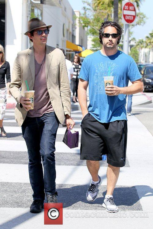 Lukas Haas and male friend wearing a fedora...