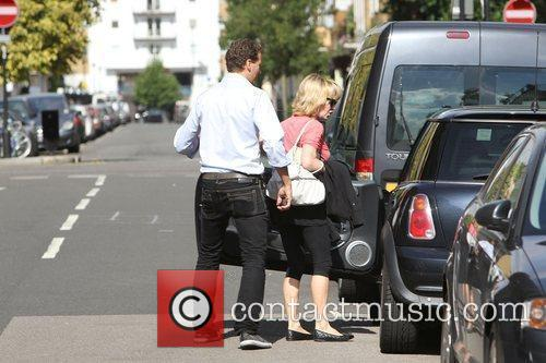 Lulu and Brendan Cole get into a taxi...