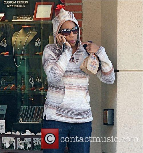 Macy Gray talking on her cellphone after leaving...