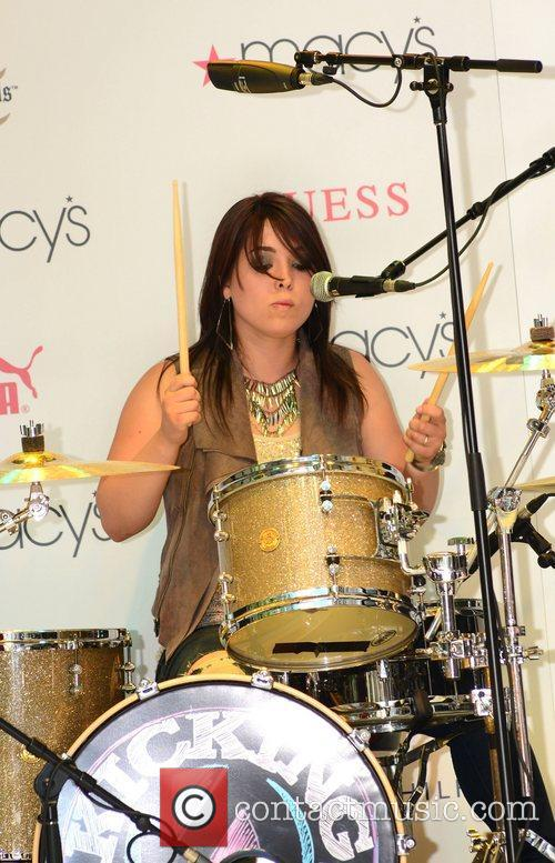 Drummer Caitlin of the Kicking Daisies,  performing...
