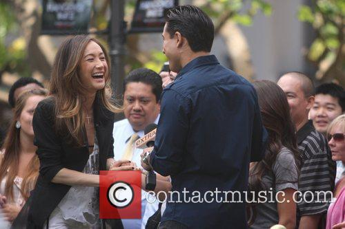 Maggie Q is seen on 'Extra' with Mario...