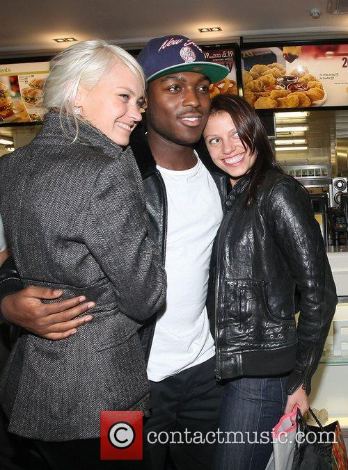Derry Mensah of The Risk posing with fans...