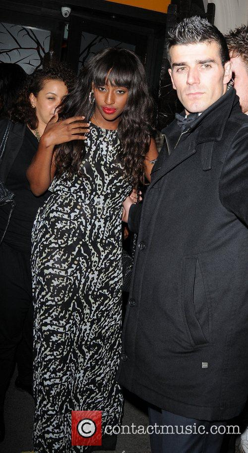 Alexandra Burke being helped as she leaves the...