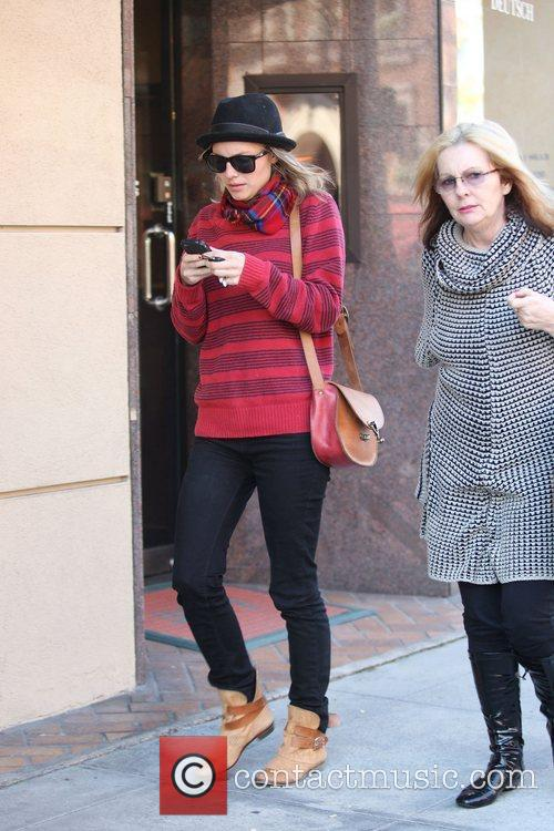Malin Akerman texting on her cellphone as she...