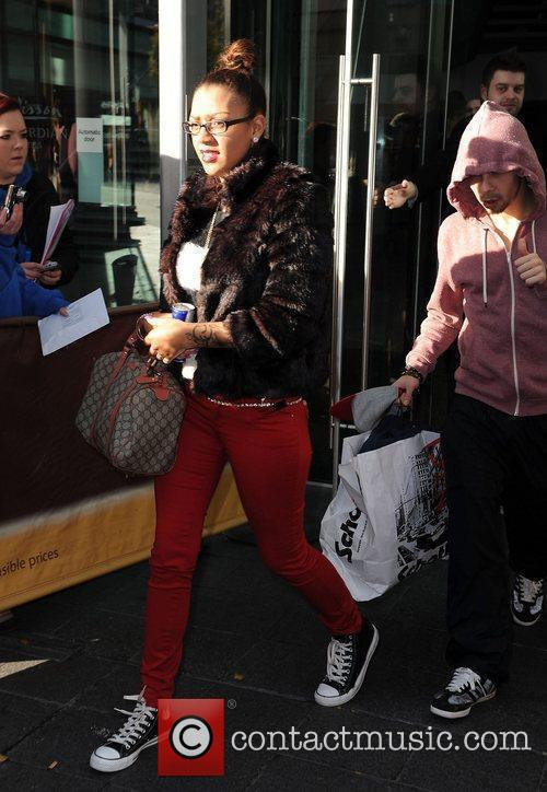 Dappy leaves his hotel with Kaye Vassell.