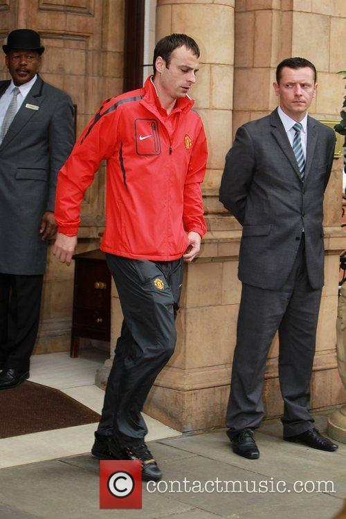 Dimitar Berbatov leaves his London hotel London, England