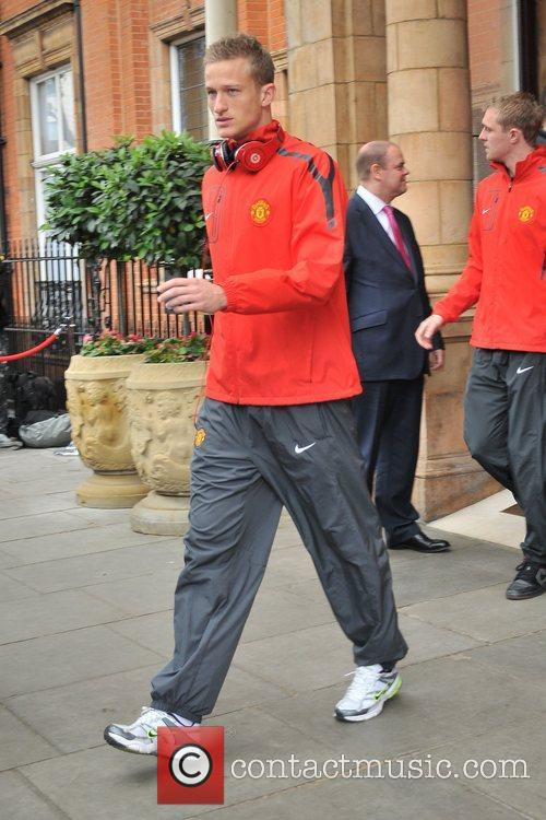 Anders Lindegaard leaves his London hotel along with...