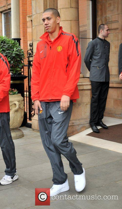 Chris Smalling leaves his London hotel along with...