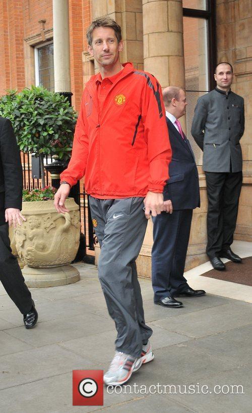 Edwin Van Der Sar leaves his London hotel...