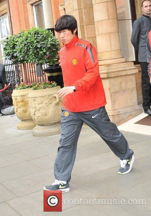 Ji-Sung Park leaves his London hotel along with...