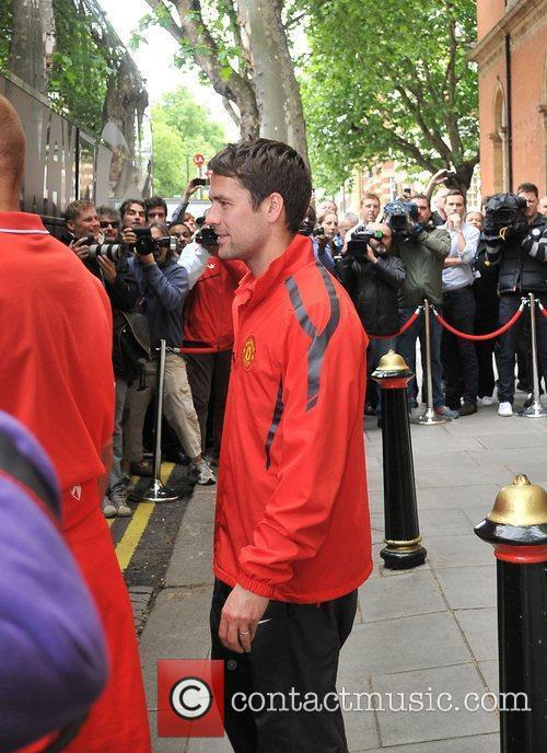 Michael Owen leaves his London hotel along with...