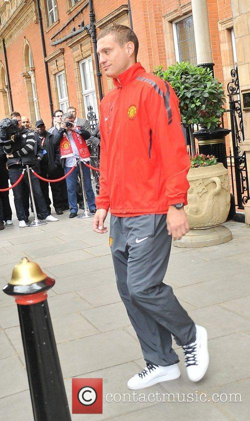 Nemanja Vidic leaves his London hotel along with...