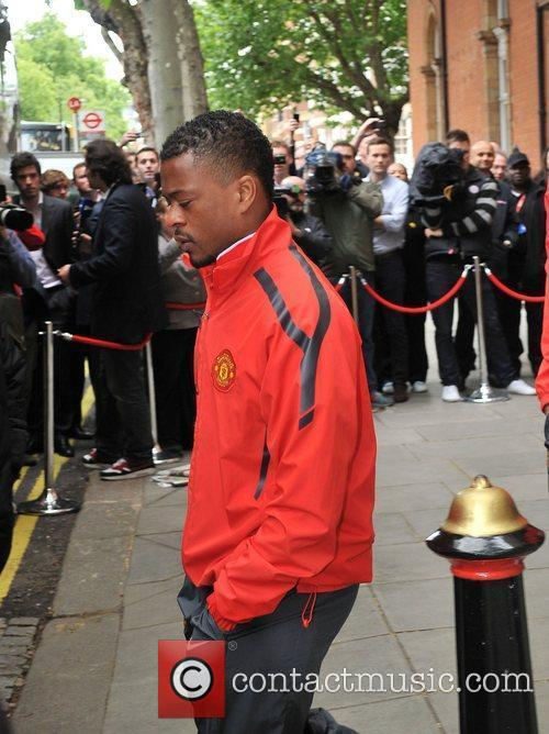 Patrice Evra leaves his London hotel along with...