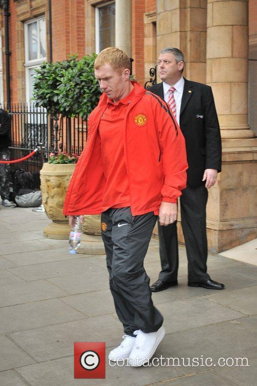 Paul Scholes leaves his London hotel along with...
