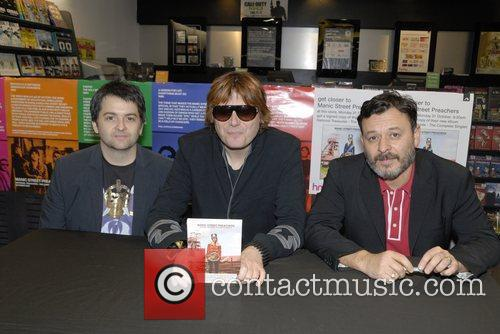 Manic Street Preachers sign copies of their new...