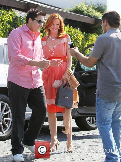 Marcia Cross poses for photographs with waiting fans...
