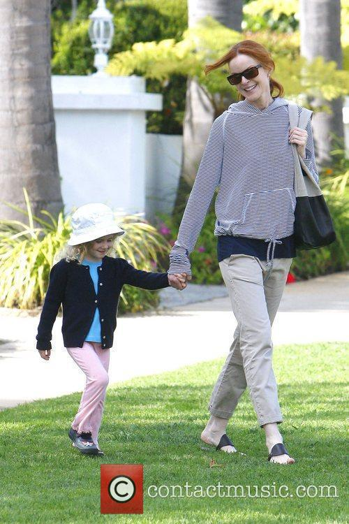Marcia Cross out carrying her daughter Eden Mahoney...