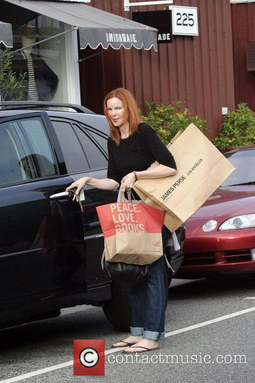 Marcia Cross returns to her car after shopping...